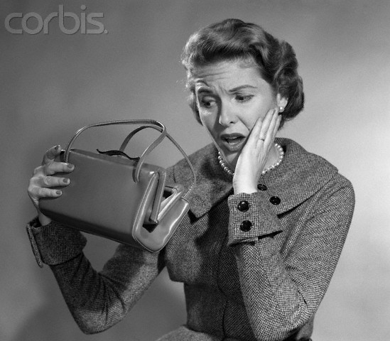 1950s Woman With Exaggerated Expression Hand On Face Looking Inside Her Purse